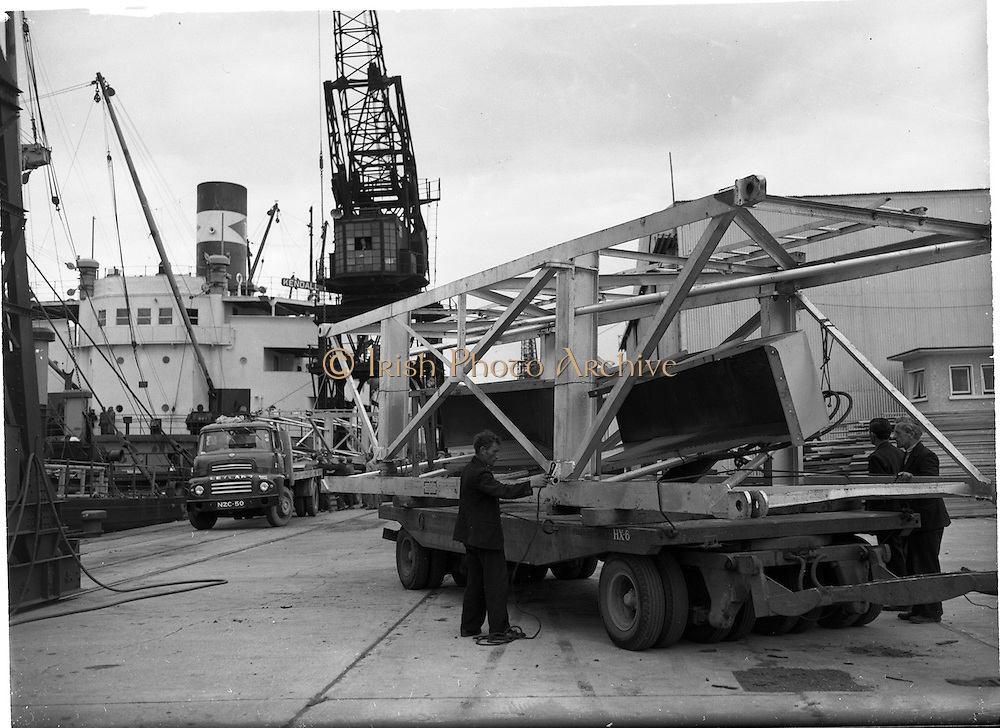 """31/07/1962<br /> 07/31/1962<br /> 31 July 1962<br /> Oil drilling equipment arrives at North Wall, Dublin. Image shows unloading of oil drilling machinery for Ambassador Irish oil. The equipment is being loaded onto CIE trucks including a Leyland from the ship """"Kendall""""."""