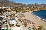 Playa Burriana sandy beach at popular holiday resort town of Nerja, Malaga province, Spain