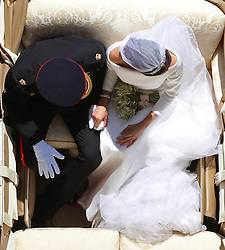 REVIEW OF THE DECADE - ROYAL File photo dated 19/05/18 of Prince Harry and Meghan Markle riding in an Ascot Landau along the Long Walk after their wedding in St George's Chapel in Windsor Castle.