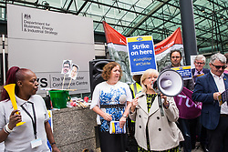 London, UK. 15 July, 2019. Mary Glindon, Labour MP for North Tyneside, addresses catering and cleaning staff belonging to the PCS trade union and outsourced to work at the Department for Business, Energy and Industrial Strategy (BEIS) via contractors ISS World and Aramark on the picket line outside the Government department after walking out on an indefinite strike for the London Living Wage, terms and conditions comparable to the civil servants they work alongside and an end to outsourcing.