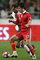 20100303: COIMBRA, PORTUGAL - Portugal vs China: International Friendly. In picture: Rolando (Portugal) and Gao Lin (China). PHOTO: CITYFILES