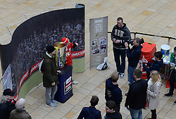 Fans have their photo taken with the Johnstone Paint Trophy final - Photo mandatory by-line: Dougie Allward/JMP - Mobile: 07966 386802 - 11/03/2015 - SPORT - Football - Bristol - Cabot Circus Shopping Centre - Johnstone's Paint Trophy