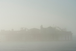 © London News Pictures. 24/09/2013 . Brighton, UK.  Brighton Pier shrouded in fog early morning on the day Ed MIliband makes his keynote speech at the 2013 Labour Party Conference in Brighton. . Photo credit : Ben Cawthra/LNP