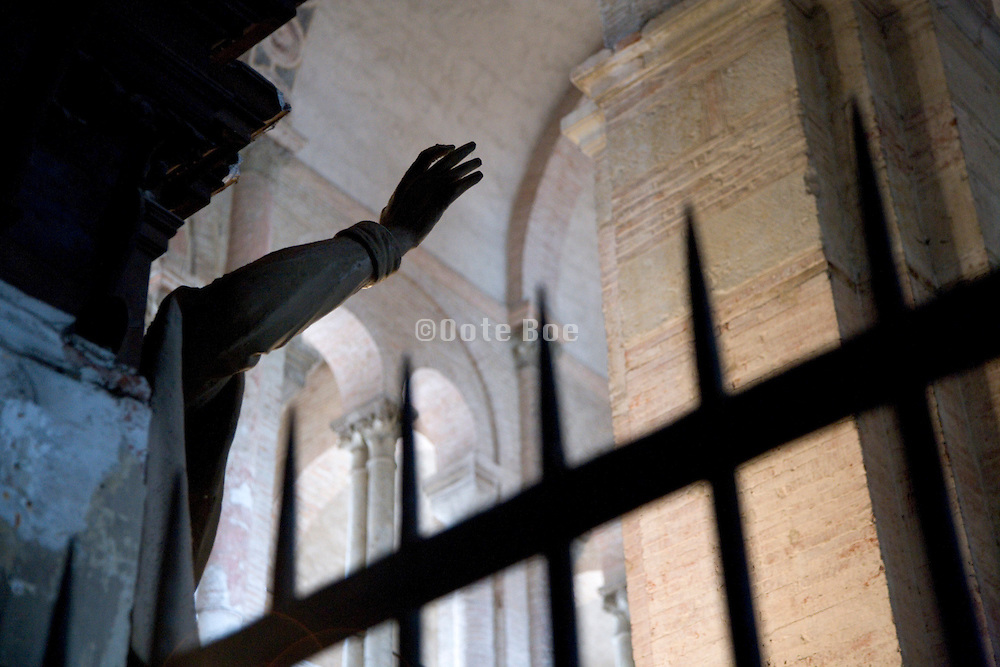 hand of a Jesus statue in a very large church