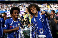 Chelsea Defender David Luiz (30) and Chelsea Midfielder Willian (22) celebrate with the trophy during the Premier League match between Chelsea and Sunderland at Stamford Bridge, London, England on 21 May 2017. Photo by Andy Walter.
