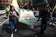 Anna Campbell banner during May Day celebrations in London, England, United Kingdom. Demonstration by unions and other organisations of workers to mark the annual May Day or Labour Day. Groups from all nationalities from around the World, living in London gathered to march to a rally in central London to mark the global workers day. Anna Campbell also known as Helin Qerecox was a British queer anarchist feminist and prison abolition activist who fought with the Kurdish Womens Protection Units YPJ in Syria. She was the first British woman to die fighting for the Kurdish forces in Rojava, Northern Syria.