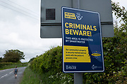 West Mercia Police sign warning sign for criminals to be aware that Smartwater is being used in this rural area on 9th June 2021 in Bishops Castle, United Kingdom. SmartWater is a traceable liquid and forensic asset marking system, aka taggant, that is applied to items of value to identify thieves and deter theft. The liquid leaves a long lasting and unique identifier, whose presence is invisible except under an ultraviolet black light.