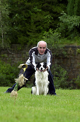 Eddie Sanders with his dog Inka practacing one of the most difficult events where Eddie has to send Inka away from him to a pre determined point. <br /> <br /> 18 June 2004<br /> <br /> Copyright Paul David Drabble<br /> <br /> [#Beginning of Shooting Data Section]<br /> Nikon D1 <br /> <br /> Focal Length: 170mm<br /> <br /> Optimize Image: <br /> <br /> Color Mode: <br /> <br /> Noise Reduction: <br /> <br /> 2004/06/18 09:21:54.5<br /> <br /> Exposure Mode: Manual<br /> <br /> White Balance: Auto<br /> <br /> Tone Comp: Normal<br /> <br /> JPEG (8-bit) Fine<br /> <br /> Metering Mode: Center-Weighted<br /> <br /> AF Mode: AF-S<br /> <br /> Hue Adjustment: <br /> <br /> Image Size:  2000 x 1312<br /> <br /> 1/200 sec - F/8<br /> <br /> Flash Sync Mode: Not Attached<br /> <br /> Saturation: <br /> <br /> Color<br /> <br /> Exposure Comp.: 0 EV<br /> <br /> Sharpening: Normal<br /> <br /> Lens: 80-200mm F/2.8<br /> <br /> Sensitivity: ISO 200<br /> <br /> Image Comment: <br /> <br /> [#End of Shooting Data Section]