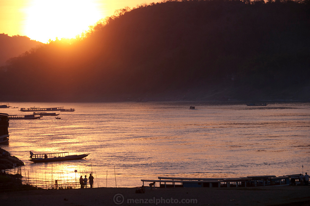 Mekong River at sunset in Luang Prabang, Laos.