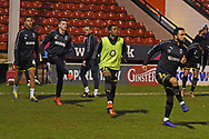 Wimbledon players warm up during the EFL Sky Bet League 1 match between Walsall and AFC Wimbledon at the Banks's Stadium, Walsall, England on 12 February 2019.