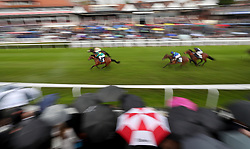 The field follow in the winner in the British Stallion Studs EBF Maiden Stakes during Boodles Ladies Day at Chester Racecourse.