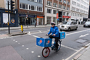 Dominoes pizza delivery rider as the national coronavirus lockdown three continues on 5th March 2021 in London, United Kingdom. With the roadmap for coming out of the lockdown has been laid out, this nationwide lockdown continues to advise all citizens to follow the message to stay at home, protect the NHS and save lives, and the streets of the capital are quiet and empty of normal numbers of people.