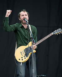 © London News Pictures. 25/08/2012. Reading, UK. James Mercer performing with The Shins on the main stage on day two of Reading Festival 2012 in Reading, Berkshire, UK on August 25, 2012. The three day event which attracts over 80,000 music fans headlines The Cure, Kasabian and The Foo Fighters Photo credit : Ben Cawthra/LNP