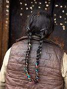 The Brokpa, the semi-nomads of the villages of Merak and Sakteng in the Himalayan Kingdom of Bhutan, have maintained many of their unique traditions and customs.  Unlike most Bhutanese women who wear their hair short, the Brokpa women keep their long hair tied up in plaits with colourful ribbons.