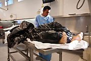 A Forensic expert wheels a recent victim of a drug related assignations at the Juarez City Forensic Lab in Juarez, Mexico January 16, 2009.  An ongoing drug war has already claimed more than 40 people since the start of the year. More than 1600 people were killed in Juarez in 2008, making Juarez the most violent city in Mexico.    (Photo by Richard Ellis)