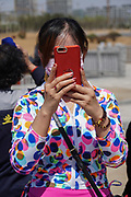 Making selfies at the opening of Rizhao construction company Dongyi Town, village festival opening, Shandong, China