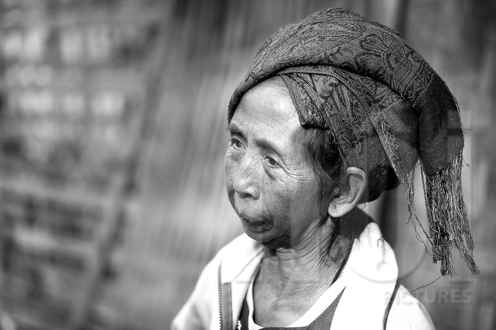 A black and white portrait of an old H'mong woman. Laos, Asia