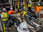 Workers remove a statue of John Sutter, a Swiss settler who built the first European settlement on the site of the city of Sacramento, outside Sutter hospital in midtown on Monday, June 15, 2020. Some historical accounts describe Sutter as using Native Americans as slaves and raping Native American girls as young as age 12.