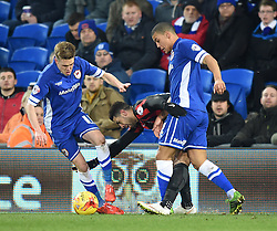 Cardiff City's Craig Noone and Lee Peltier tangle with Brighton and Hove Albion's Leon Best - Photo mandatory by-line: Paul Knight/JMP - Mobile: 07966 386802 - 10/02/2015 - SPORT - Football - Cardiff - Cardiff City Stadium - Cardiff City v Brighton & Hove Albion - Sky Bet Championship
