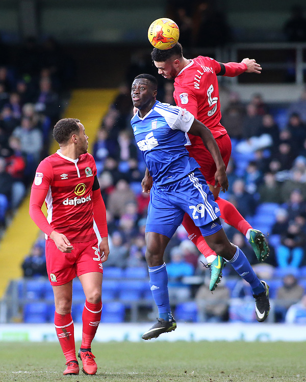 Blackburn Rovers' Derrick Williams heads away from Ipswich Town's Josh Emmanuel<br /> <br /> Photographer David Shipman/CameraSport<br /> <br /> The EFL Sky Bet Championship - Ipswich Town v Blackburn Rovers - Saturday 14th January 2017 - Portman Road - Ipswich<br /> <br /> World Copyright © 2017 CameraSport. All rights reserved. 43 Linden Ave. Countesthorpe. Leicester. England. LE8 5PG - Tel: +44 (0) 116 277 4147 - admin@camerasport.com - www.camerasport.com