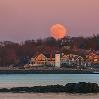 Beaver full moon rise over Annisquam Lighthouse in Gloucester, MA on Cape Ann, Massachusetts. Photography image taken from Wingaersheek Beach.<br />