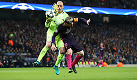 Football - 2016 / 2017 UEFA Champions League - Group C: Manchester City vs. Barcelona<br /> <br /> Willy Caballero of Manchester City grabs the ball ahead of Lionel Messi of Barcelona during the match at The Etihad Stadium.<br /> <br /> COLORSPORT/LYNNE CAMERON