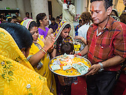 05 SEPTEMBER 2015 - BANGKOK, THAILAND: People pray and make offerings during the Janmashtami services at the Vishnu Temple in Bangkok. Janmashtami is the annual celebration of the birth of the Hindu deity Krishna, the eighth avatar of Vishnu. Hindus celebrate Janmashtami by fasting, worshipping Krishna and staying up until midnight, the time when Krishna is believed to have been born. At midnight they pray and exchange small gifts.     PHOTO BY JACK KURTZ