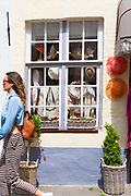 Ladies clothing and souvenir shops in Walstraat shopping street in Bruges, Belgium
