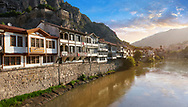 Ottoman villas of Amasya along the banks of the river Yeşilırmak, below the Pontic Royal rock tombs and mountain top ancient citadel at sunrise, Turkey .<br /> <br /> If you prefer to buy from our ALAMY PHOTO LIBRARY  Collection visit : https://www.alamy.com/portfolio/paul-williams-funkystock/amasya-turkey.html<br /> <br /> Visit our TURKEY PHOTO COLLECTIONS for more photos to download or buy as wall art prints https://funkystock.photoshelter.com/gallery-collection/3f-Pictures-of-Turkey-Turkey-Photos-Images-Fotos/C0000U.hJWkZxAbg