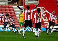 Photo: Alan Crowhurst.<br />Southampton v Norwich City. Coca Cola Championship. 16/12/2006. Saints Gareth Bale (L) turns away after scoring from a free kick 1-1.