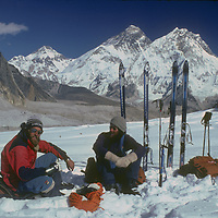 Mountaineers Jay Jensen & Dr. Peter Hackett, relax on the Changri Glacier after skiing slopes near Mount Everest, which towers in the background.