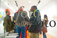 Huntington, New York, U.S. - March 1, 2014 - The Opening Reception '3 Wild and Crazy Artists' at FotoFoto Gallery, seen through front window, presents fine art photography works.