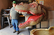 Jeremy Bush sculpts dinosaurs for the Burning Tree Casting Co in Newark, OH after his boss found and sold a mastodon skeleton for $600,000.
