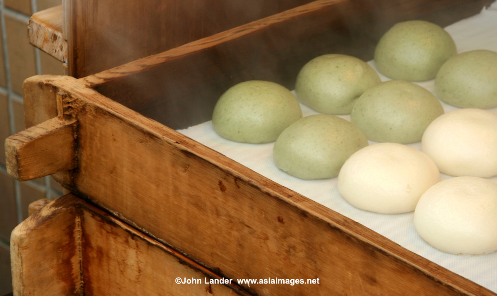 Manju, a special type of Japanese confectionary filled with sweet bean paste and steamed. Manju are typically eaten as a snack.