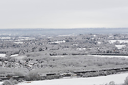 © Licensed to London News Pictures. 17/01/2016. Woldingham, UK. The M25 (bottom), surrounded the snow covered Surrey Hills are seen from the top of the North Downs today (17/01/2016) after snow hit parts of the UK for the first time this winter. Photo credit: Matt Cetti-Roberts/LNP