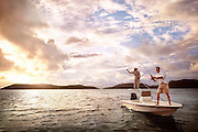 Two men fish off a small boat at sunset in water off the British Virgin Islands