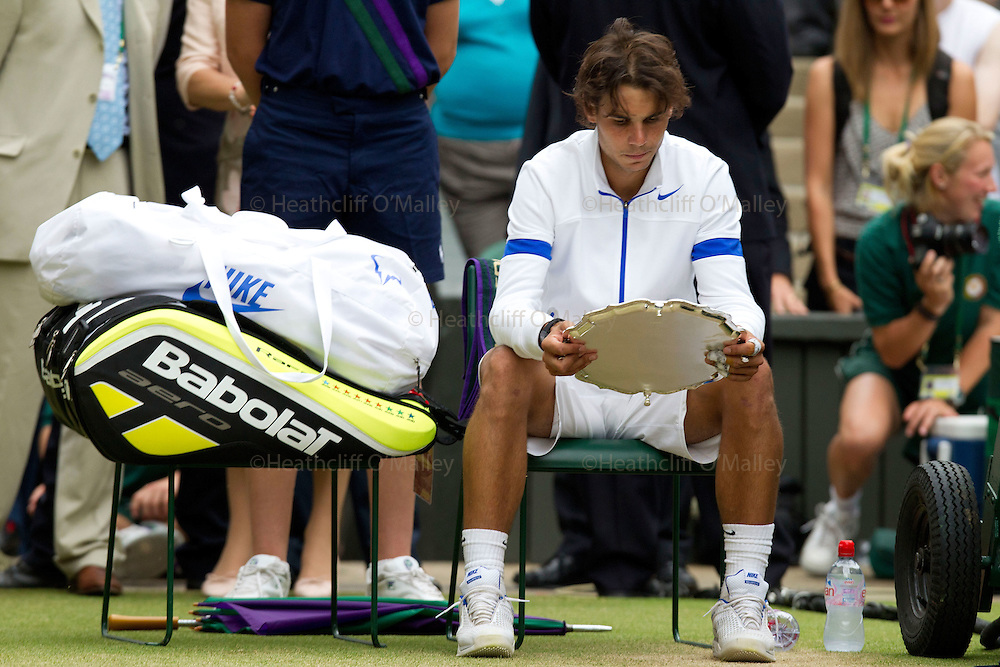 Mcc0032212 . Daily Telegraph..A dejected looking Rafael Nadal after being defeated by Novak Djokovic in the Mens Finals at Wimbledon..Rafael Nadal vs Novak Djokovic in the Mens Singles Finals...The thirteenth and final day of The Lawn Tennis Championships at Wimbledon..London 3 July 2011