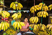06 JUNE 2014 - IRRAWADDY DELTA,  AYEYARWADY REGION, MYANMAR:  A woman sells bananas in the market in Pantanaw, a town in the Irrawaddy Delta (or Ayeyarwady Delta) in Myanmar. The region is Myanmar's largest rice producer, so its infrastructure of road transportation has been greatly developed during the 1990s and 2000s. Two thirds of the total arable land is under rice cultivation with a yield of about 2,000-2,500 kg per hectare. FIshing and aquaculture are also important economically. Because of the number of rivers and canals that crisscross the Delta, steamship service is widely available.  PHOTO BY JACK KURTZ