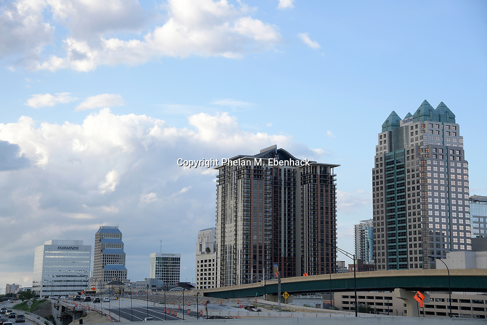 Traffic moves along Interstate 4 past the high-rise buildings Saturday, June 24, 2017, in downtown Orlando, Fla. (Photo by Phelan M. Ebenhack)