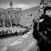 A member of the anti-terrorist brigade watches over the Wall of Lamentations. Jerusalem.<br />