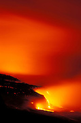 Lava flow entering the Pacific Ocean at night, Hawaii Volcanoes National Park, The Big Island, Hawaii