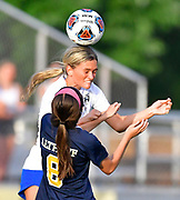 Columbia defender Taylor Martin (top) wins the header from Althoff midfielder Issy Wendler. Althoff played Columbia in the sectional championship game at Althoff High School in Belleville, IL on Friday June 11, 2021. <br /> Tim Vizer/Special to STLhighschoolsports.com.