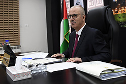December 18, 2018 - Ramallah, West Bank, Palestinian Territory - Palestinian Prime Minister Rami Hamdallah chairs a meeting with council of Ministers in the West Bank city of Ramallah on December 18, 2018  (Credit Image: © Prime Minister Office/APA Images via ZUMA Wire)