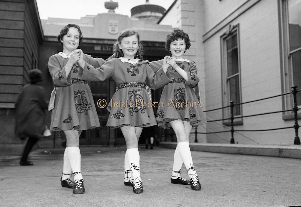 Three young Limerick lasses line up prior to competing in the Irish Dancing Championships . L to R: Máire Ní Charthaigh, Deirdre Ní Chearbhaill and Magella Nic Mathúna, all from Scoil Rince Ui Ruairc..21.02.1965