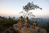 """Buddha statues on a hilltop, Mrauk-U, Rakhine State, Myanmar<br /> Available as Fine Art Print in the following sizes:<br /> 08""""x12""""US$   100.00<br /> 10""""x15""""US$ 150.00<br /> 12""""x18""""US$ 200.00<br /> 16""""x24""""US$ 300.00<br /> 20""""x30""""US$ 500.00"""