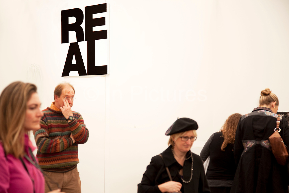 Visitors and exhibitors at the many galleries exhibiting at the Frieze Art Fair 2010. This art fair is for work at the high end of international contemporary art with many well known artists on show from many of the world's most reknowned dealers.
