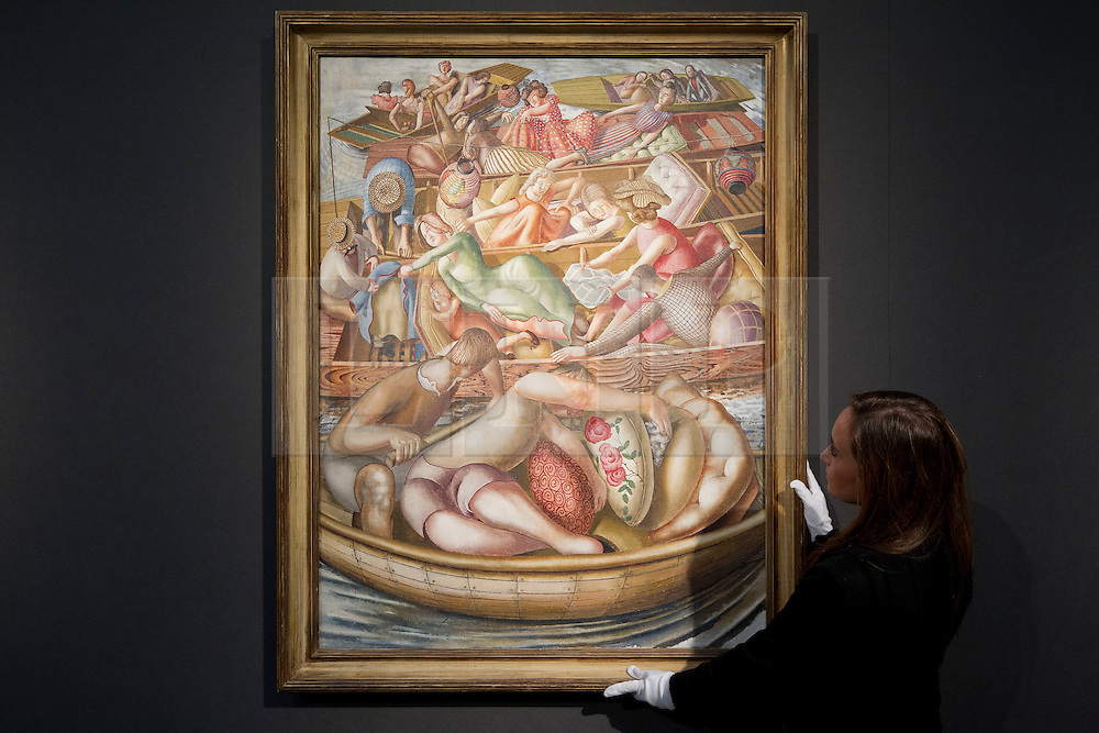 "© Licensed to London News Pictures. 18/11/2013. London, UK. A member of Christie's staff adjusts British artist Sir Stanley Spencer's 1955 painting ""Christ Preaching at the Cookham Regatta: Conversation Between Punts""  (est. GB£3,000,000 - 5,000,000) at the press view for a sale of modern British and Irish art at Christie's St James' auction house in London today (18/11/2013). The sale is set to take place on Wednesday the 20th and Thursday the 21st of November 2013. Photo credit: Matt Cetti-Roberts/LNP"