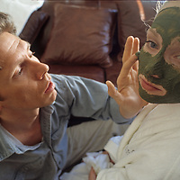 A beautician at the Summit Lodge Spa paint a facial masque onto a guest at Montana's Big Sky Resort.