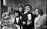 1980-03-09.9th March 1980.09-09-1980.03-09-80..Photographed at RTE Montrose, Dublin..What's Another Year..From Left:..Shay Healey, who wrote the winning song What's Another Year..Johnny Logan, centre), the winning singer..Larry Gogan, (fourth from left), Compere..