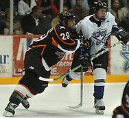 1/5/07 -- Omaha, NE<br />  -- USHL Omaha Lancer Nick Petrecki hits Lincoln Stars player STEVE SCHULTZ Friday night.<br /> Photo by Chris Machian, Prairie Pixel Group